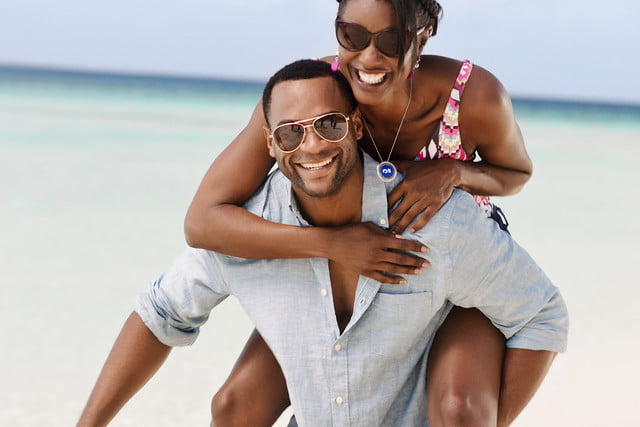 carnival ocean medallion how it works couple on beach wearing