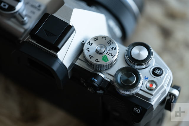 Close-up of mode dial, shutter button on Olympus OM-D E-M5 Mark III camera.