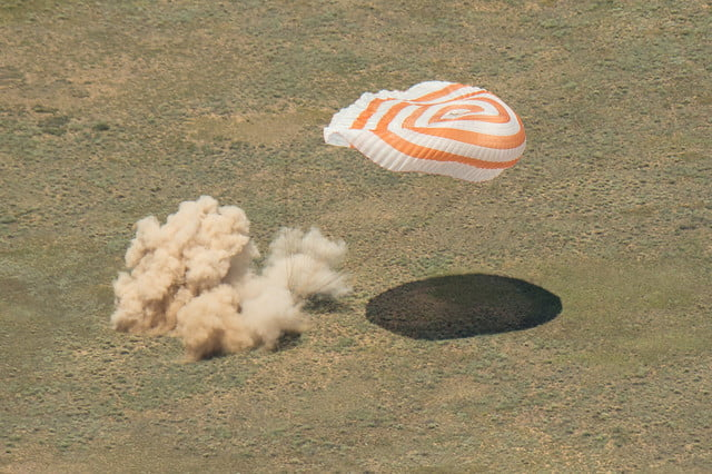 iss astronaut trio return to earth soyuz landing 4