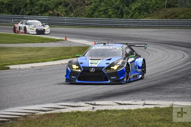 Shot of the Lexus RC F GT3 turning a corner ahead of another car
